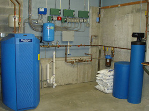 Buderus Domestic 80 gallon Hot Water System on left. Constant Pressure System in Center and Filtration/Softening System on Right