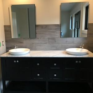 Master Bath vanity finish is a double vanity with vessel sinks and single handle faucets