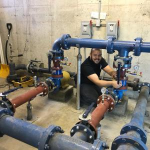 Johnny making final adjustments to 15 HP Pump suction flanges for new 15 HP booster pump complete.