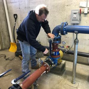 Gene installing check value on new 15 HP Installation.