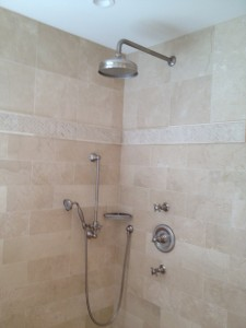 Master bath shower with rain head and hand held shower on slide bar with thermostatic valve and 2 volume controls.