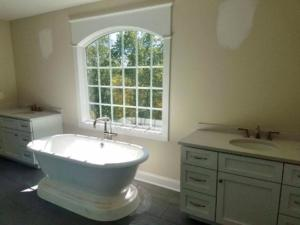 Tub between vanity